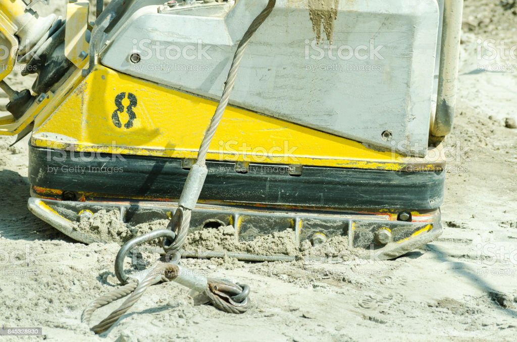 Compactor machinery at street reconstruction site closeup stock photo