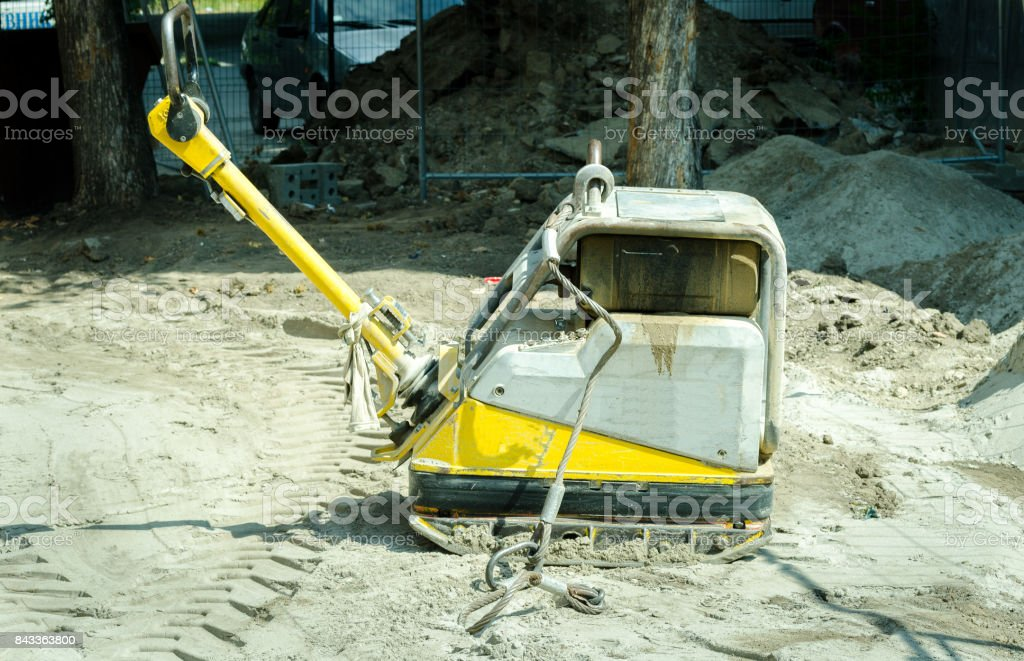 Compactor machinery at street reconstruction site stock photo