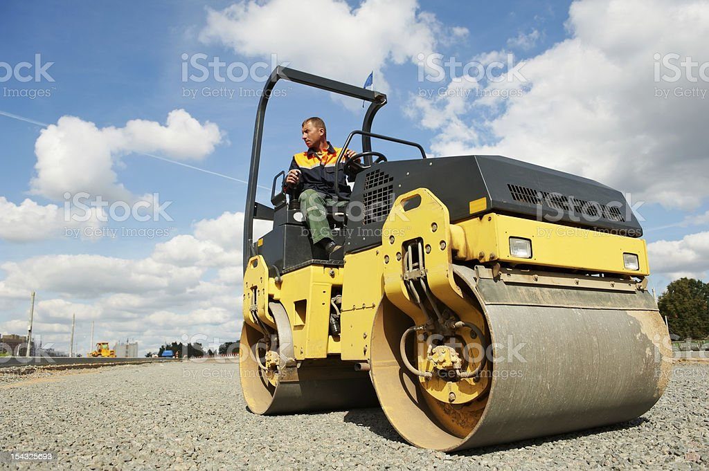 compactor roller at road work stock photo