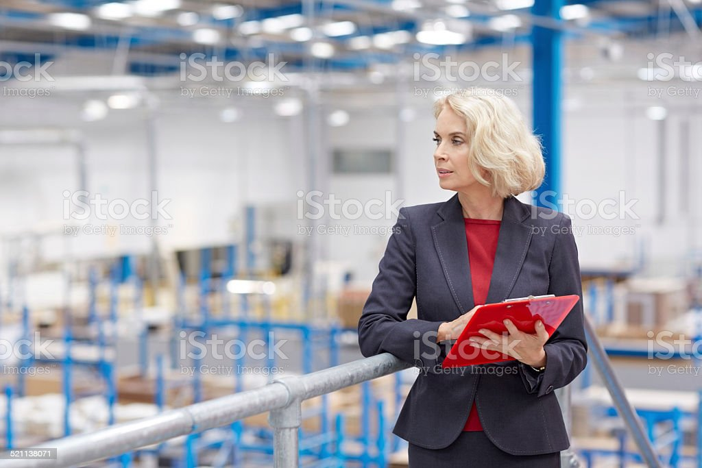 Company executive doing inspection in warehouse stock photo