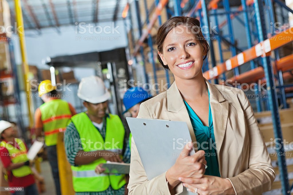 Company executive leading inspection in shipping distribution warehouse royalty-free stock photo
