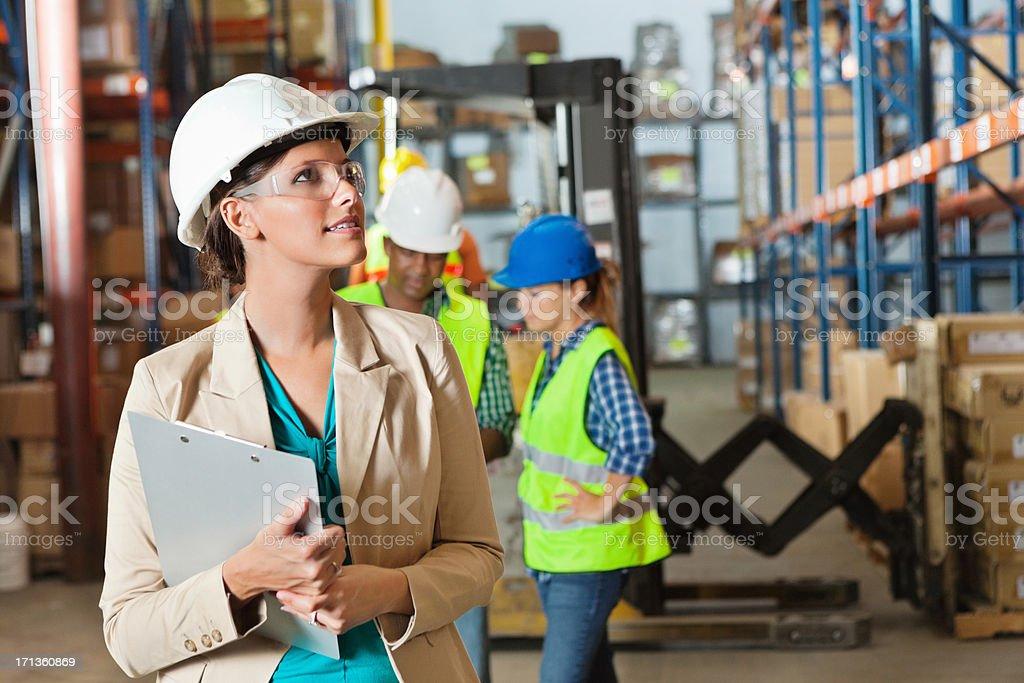 Company executive touring shipping distribution warehouse royalty-free stock photo