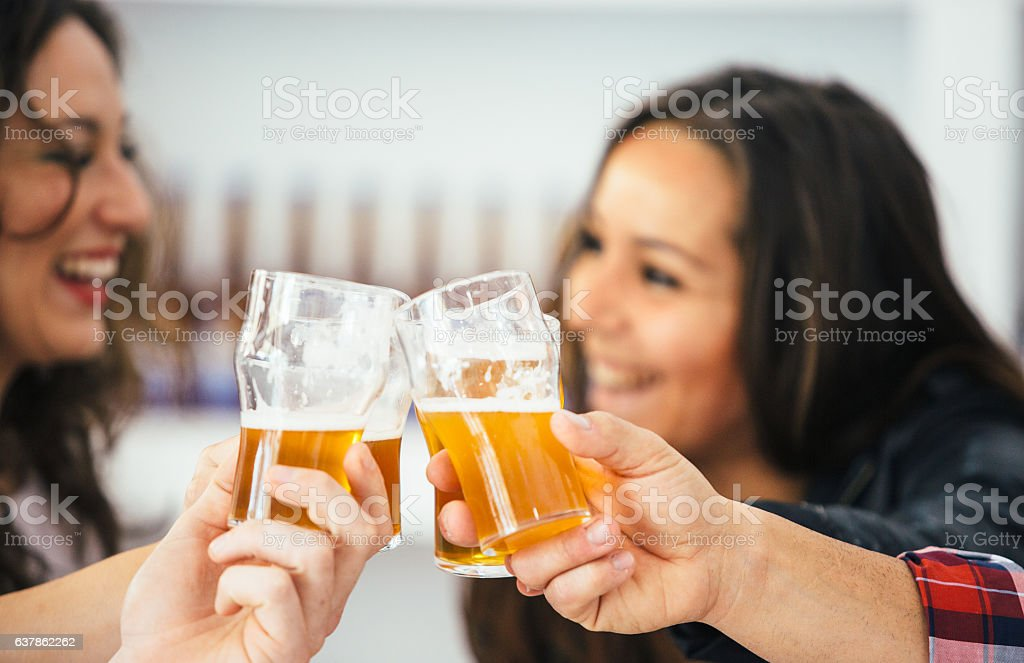 Company of four toasting with glasses stock photo