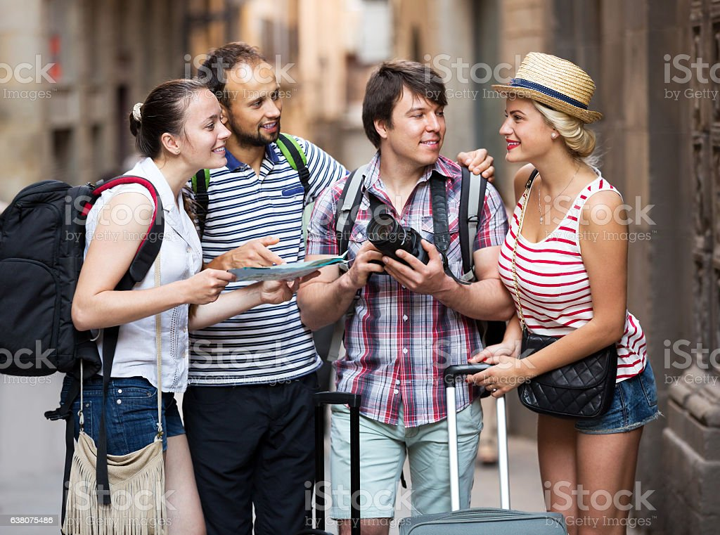 Company of impressed travelers stock photo