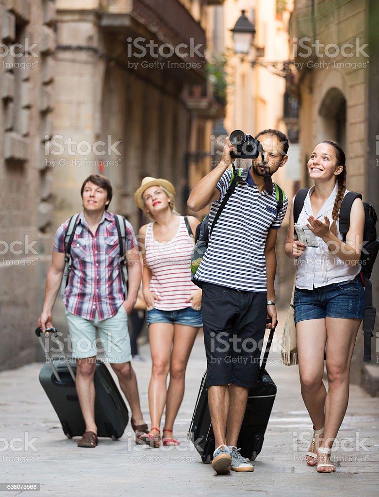 Company of  travelers taking shots stock photo