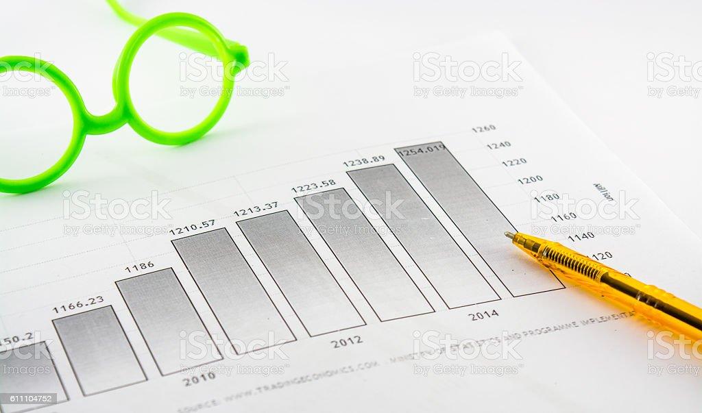company progress,histograms,ballpoint pen,glasses etc stock photo