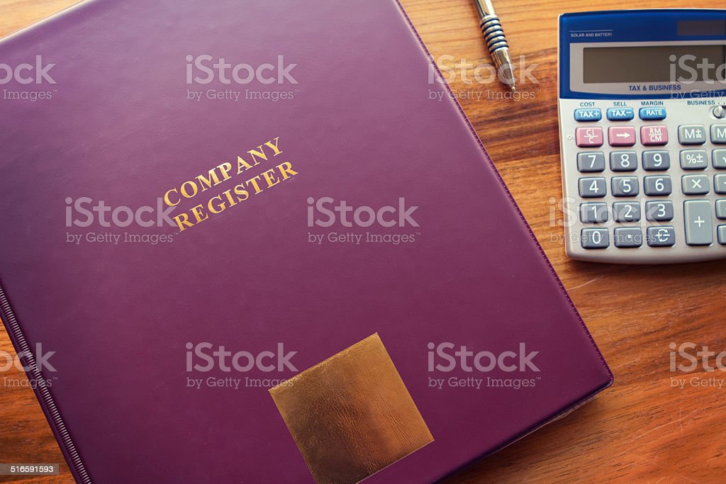 Company Register documents with pen and calculator stock photo