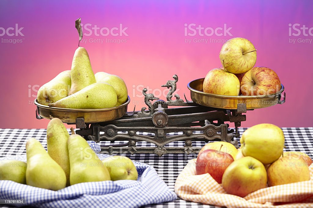 Compare apples to pears royalty-free stock photo
