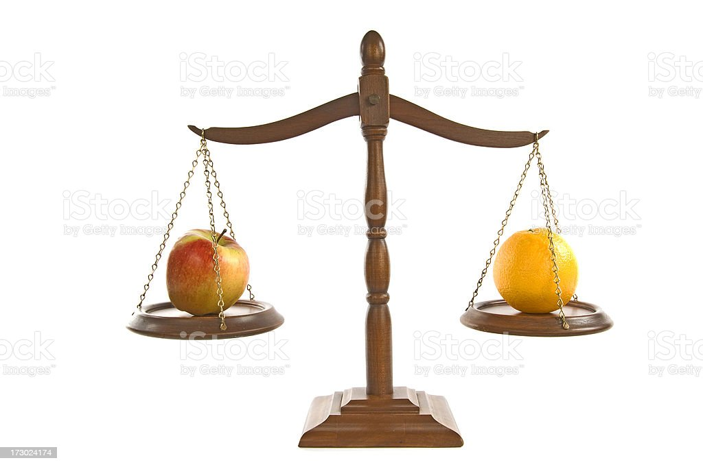 Comparing Apples and Oranges royalty-free stock photo