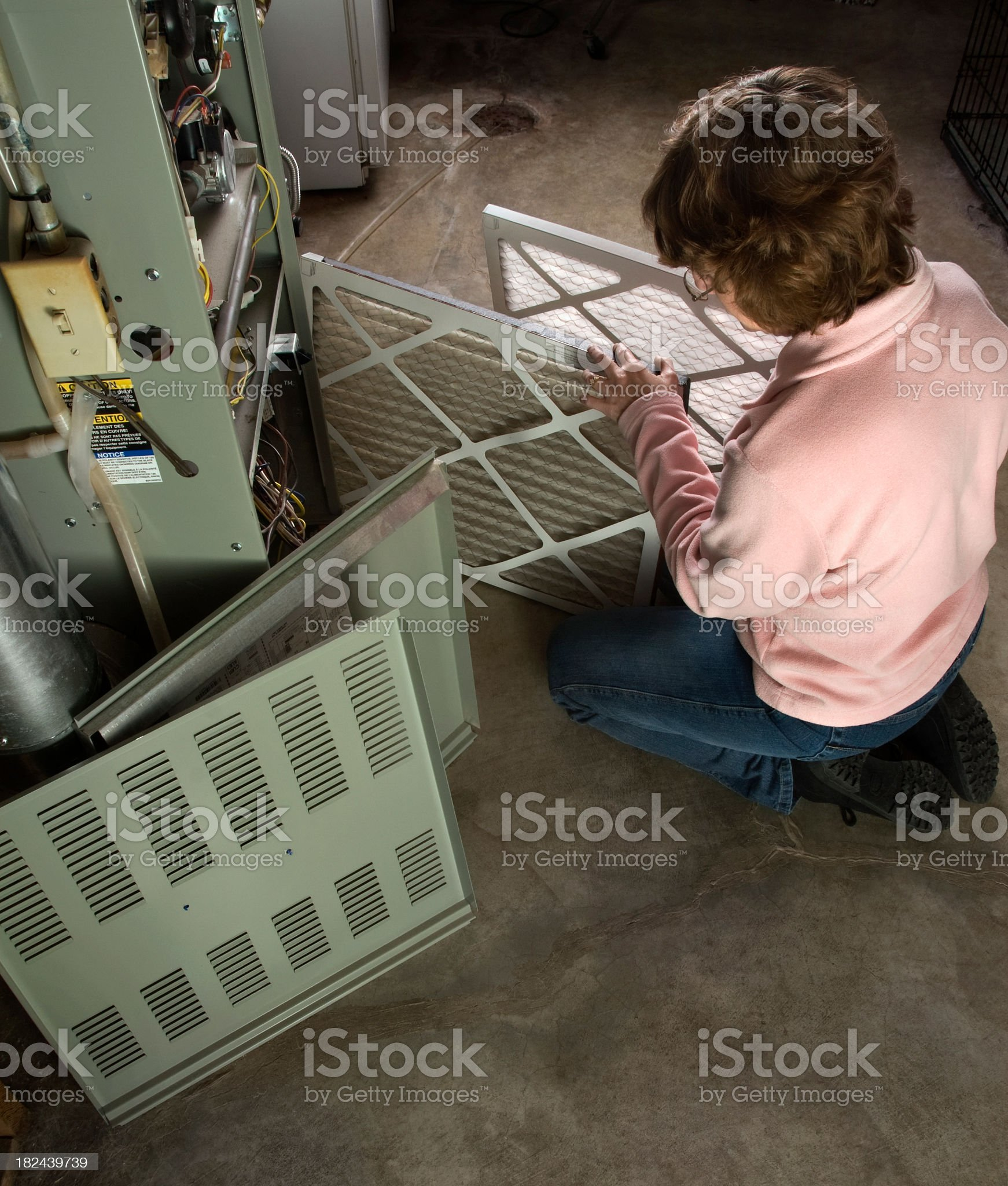 Comparing Dirty and New Furnace Air Filters royalty-free stock photo