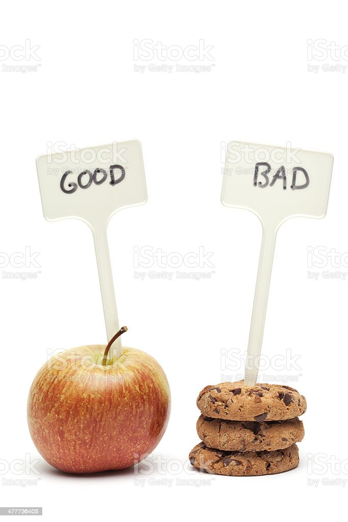 Comparing Foods - Apple and Cookies stock photo
