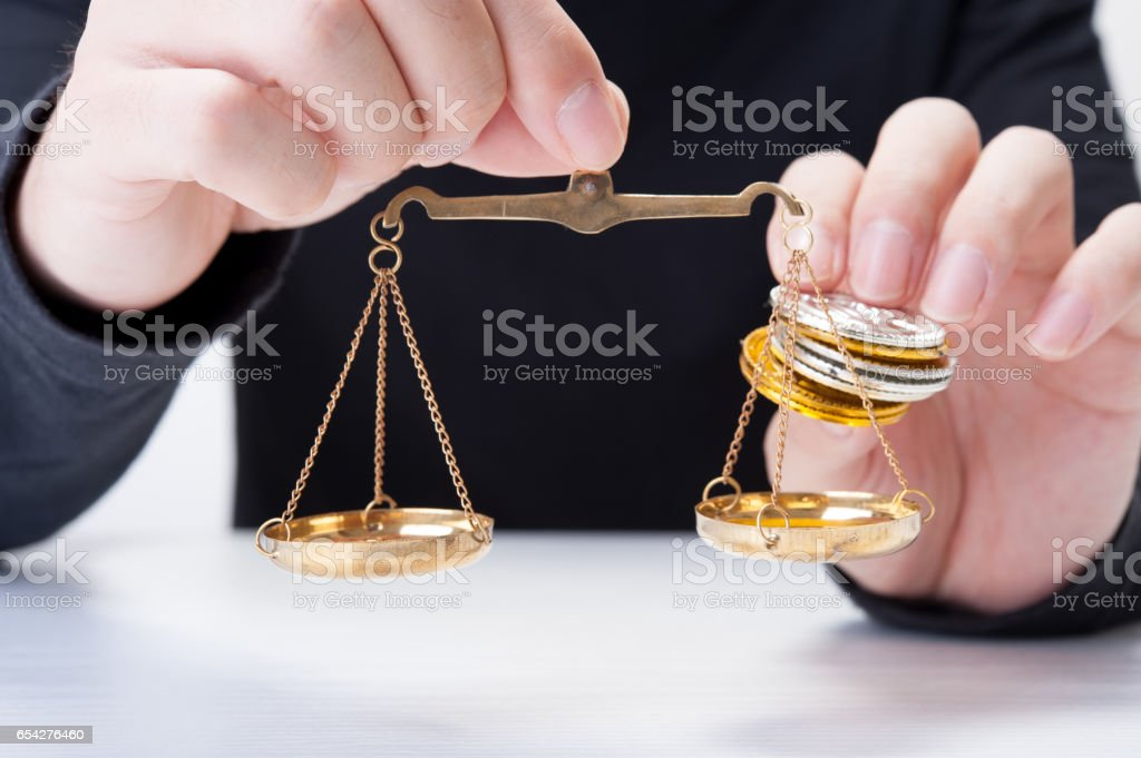 Comparing gold and silver coins stock photo