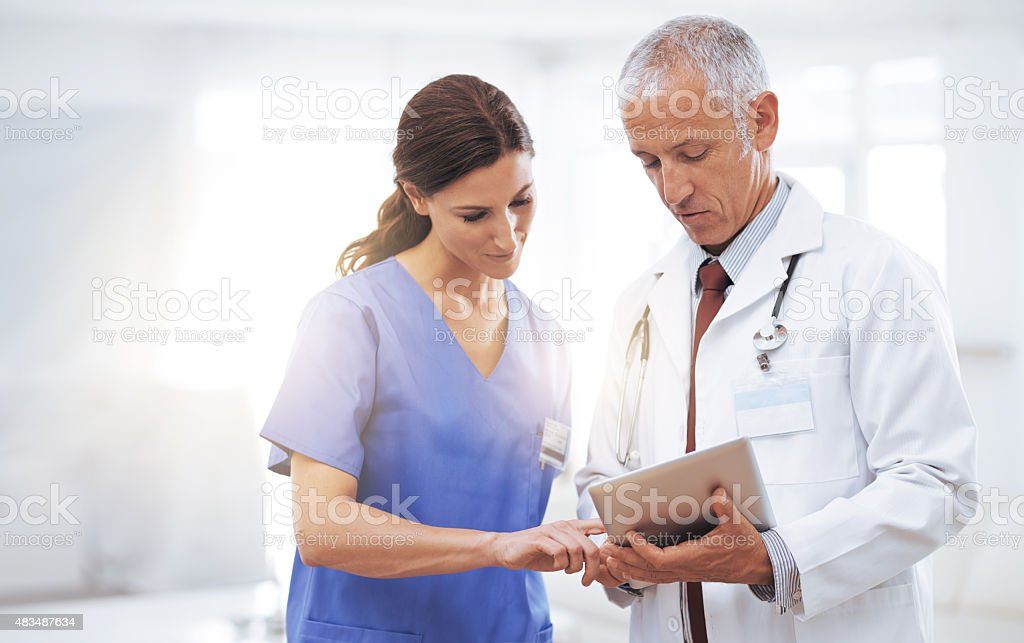 Comparing medical records stock photo