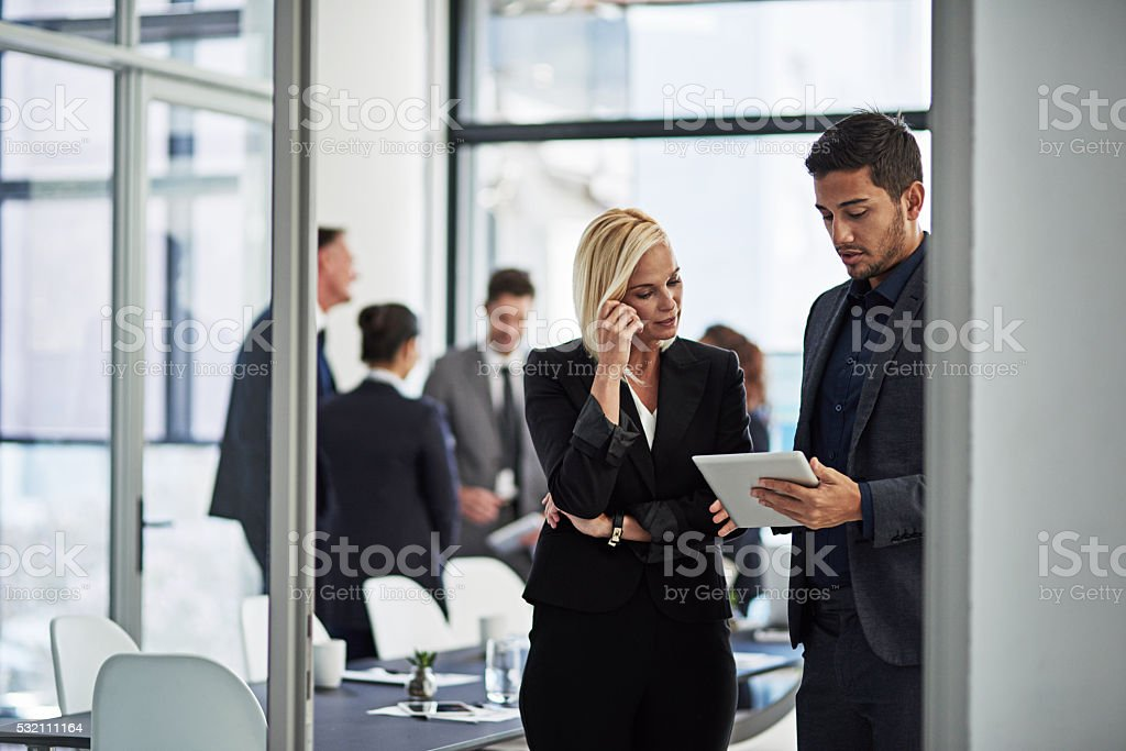 Comparing notes and ideas after the meeting stock photo