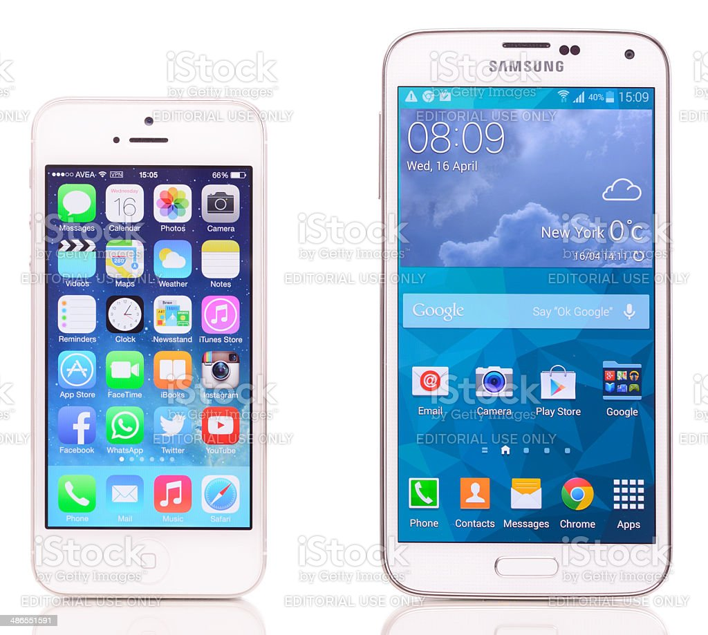 Comparing Samsung Galaxy S5 and iPhone 5 stock photo