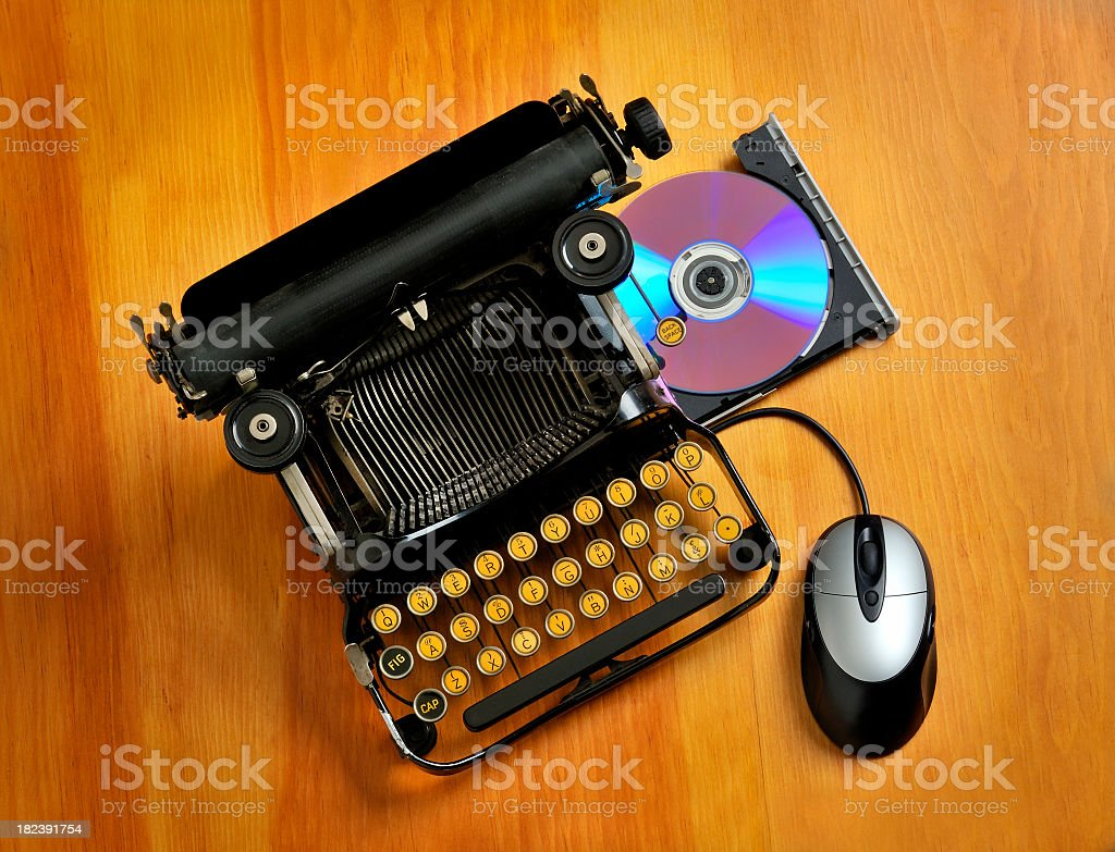 Comparison between an old typewriter and a computer stock photo