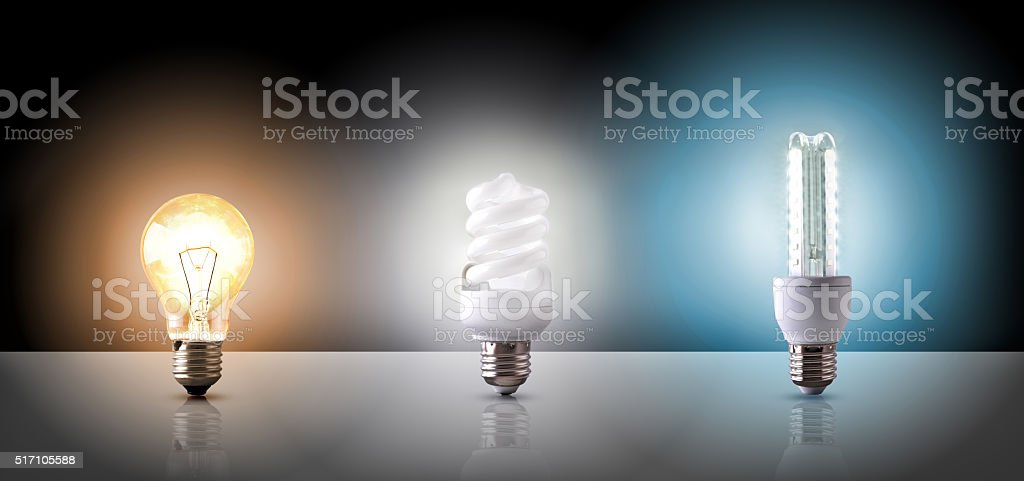 Comparison between various types of light bulb on black backgrou stock photo