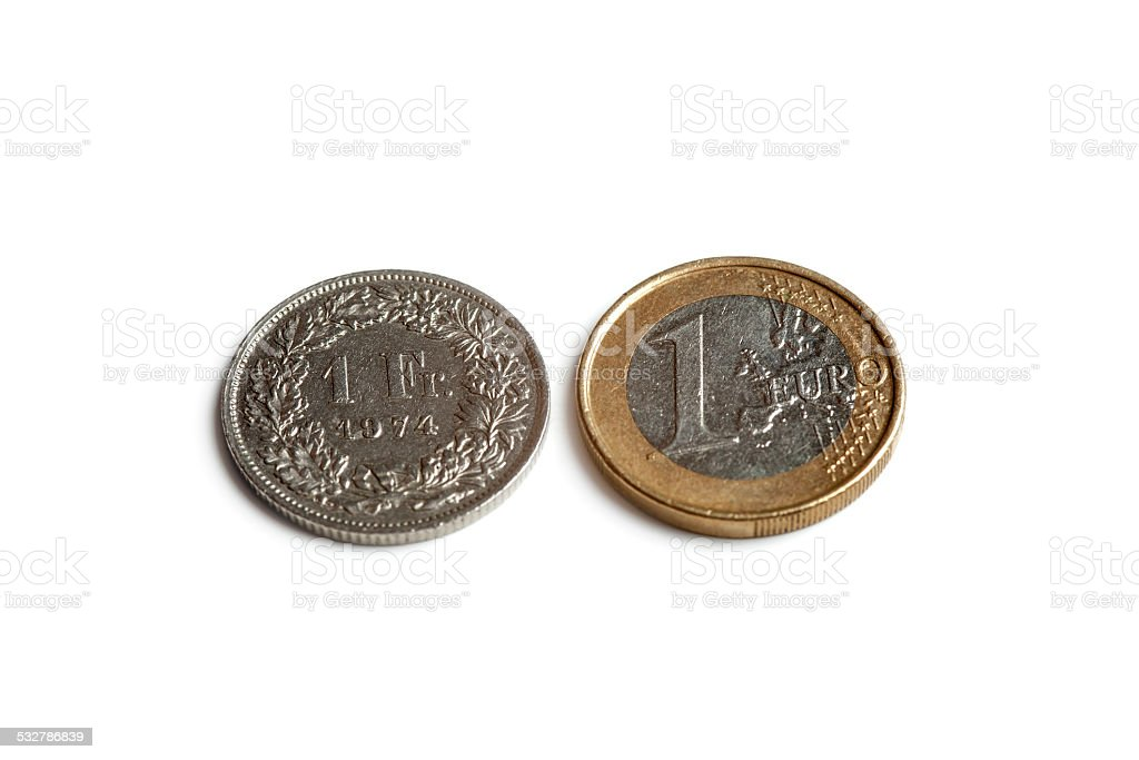 comparison currency euro vs swiss franc stock photo