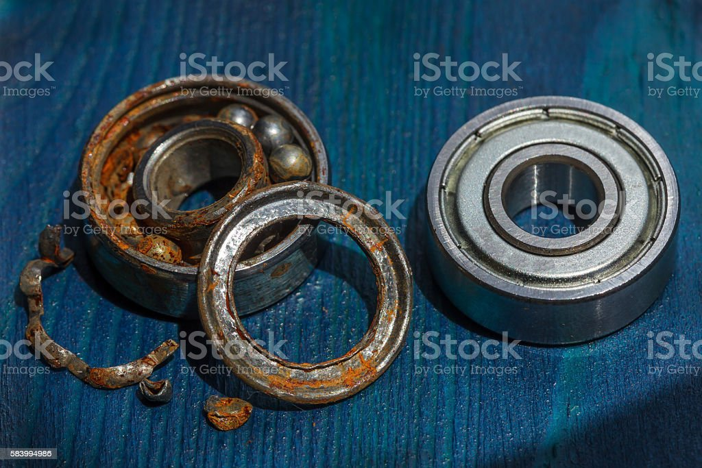 Comparison of old and new bearing stock photo