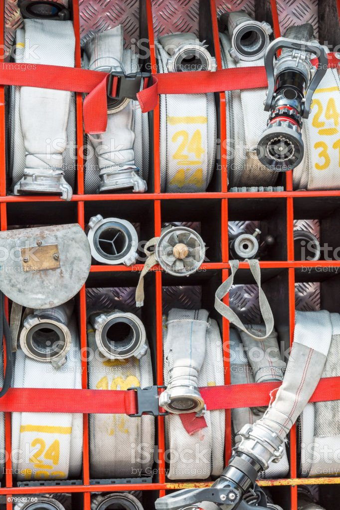 compartment of rolled up fire hoses on fire truck stock photo