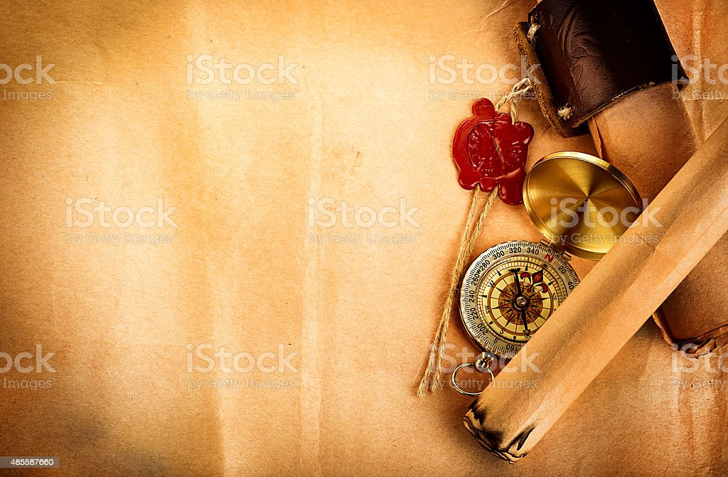 compass, ancient scroll with red wax seal on old paper stock photo