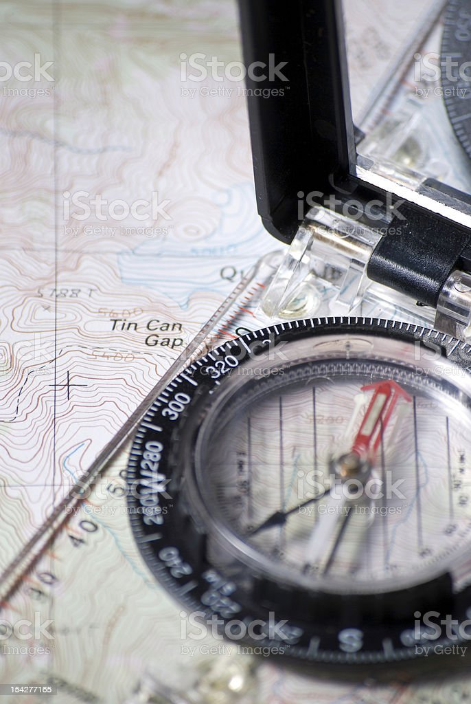 Compass and a map. royalty-free stock photo