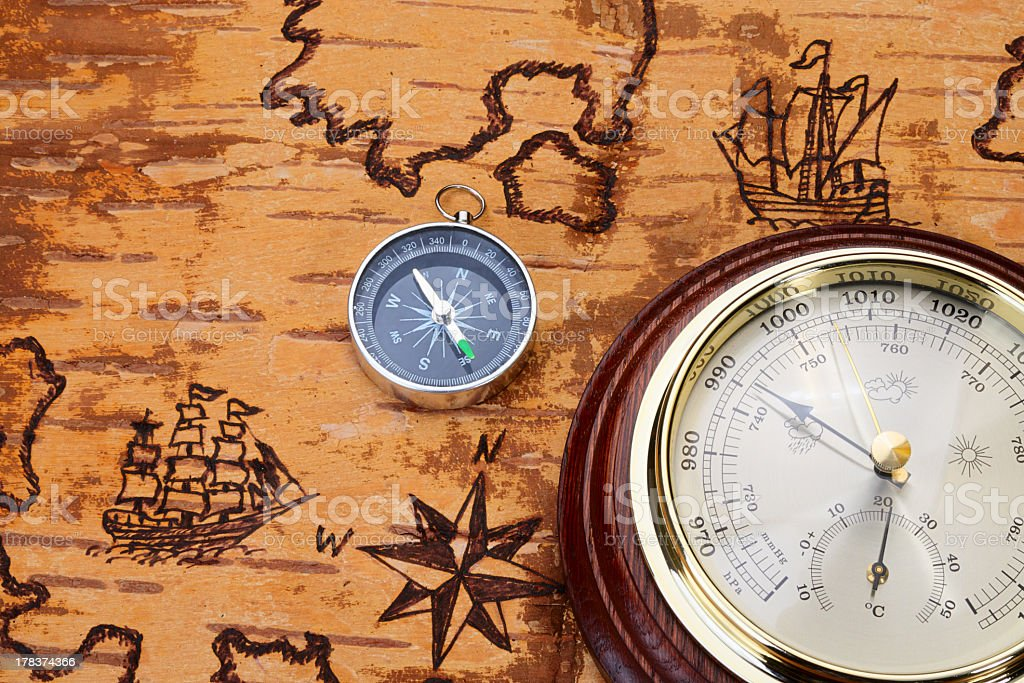 Compass and barometer on sea chart royalty-free stock photo