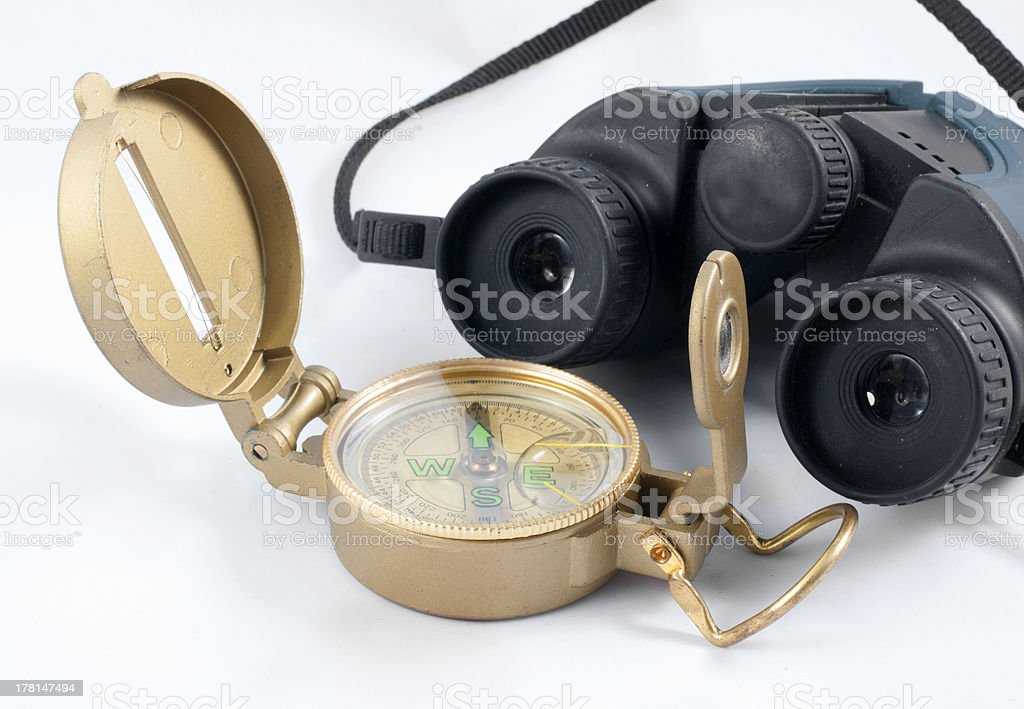 compass and binoculars royalty-free stock photo