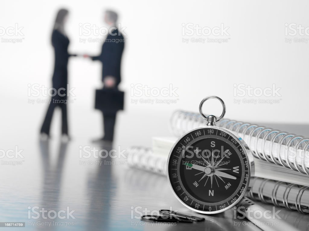Compass and Business Meeting royalty-free stock photo