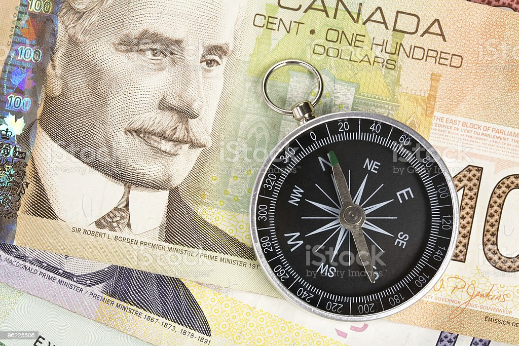 Compass and canadian dollar stock photo