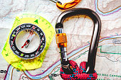 Compass and Carabiner with Climbing Rope on Map