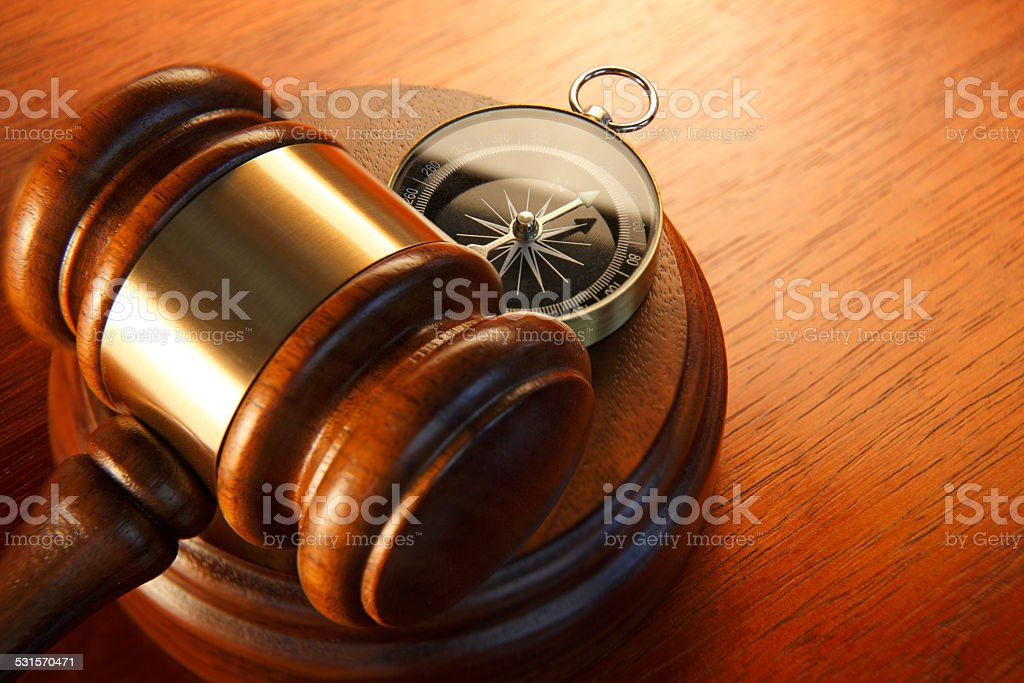 Compass and gavel on sound block stock photo