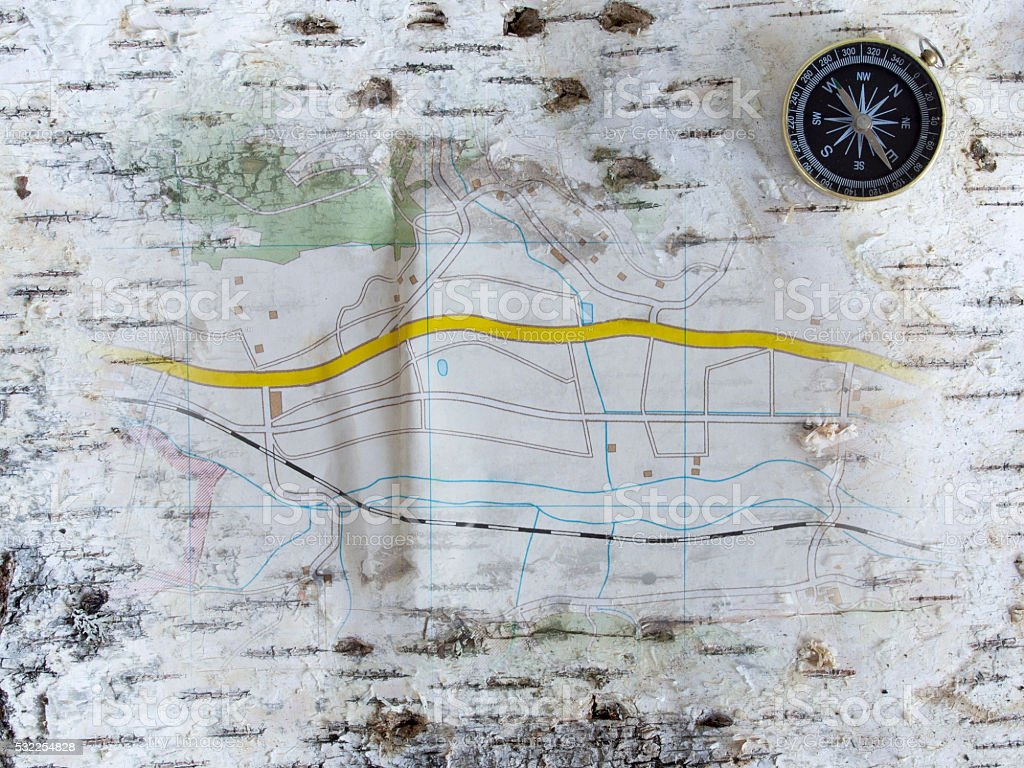 Compass and map on birchen cork stock photo