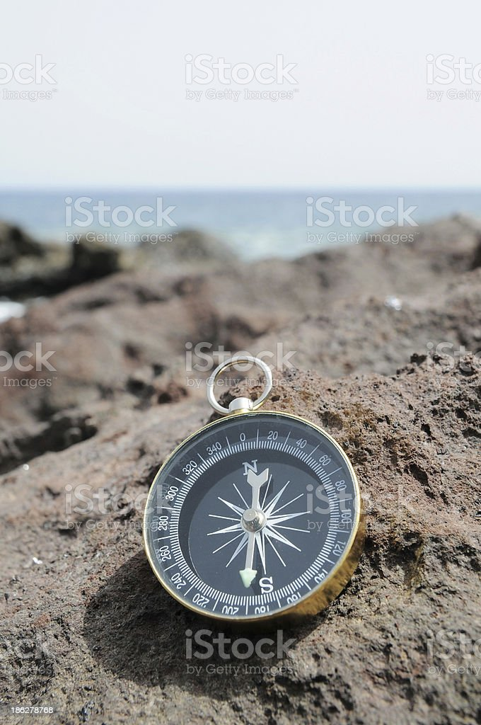 Compass and Ocean - Orientation Concept royalty-free stock photo
