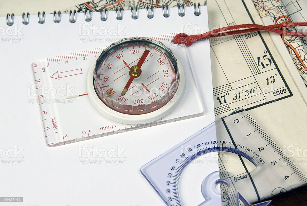 Compass and old maps royalty-free stock photo