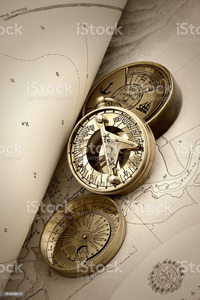 Compass and old navigation chart stock photo