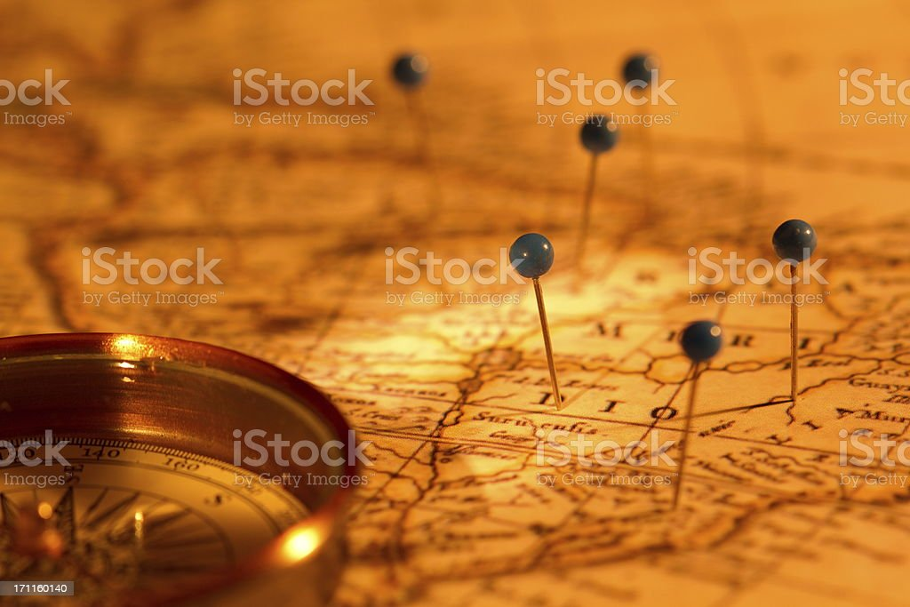 Compass and pins on a map stock photo