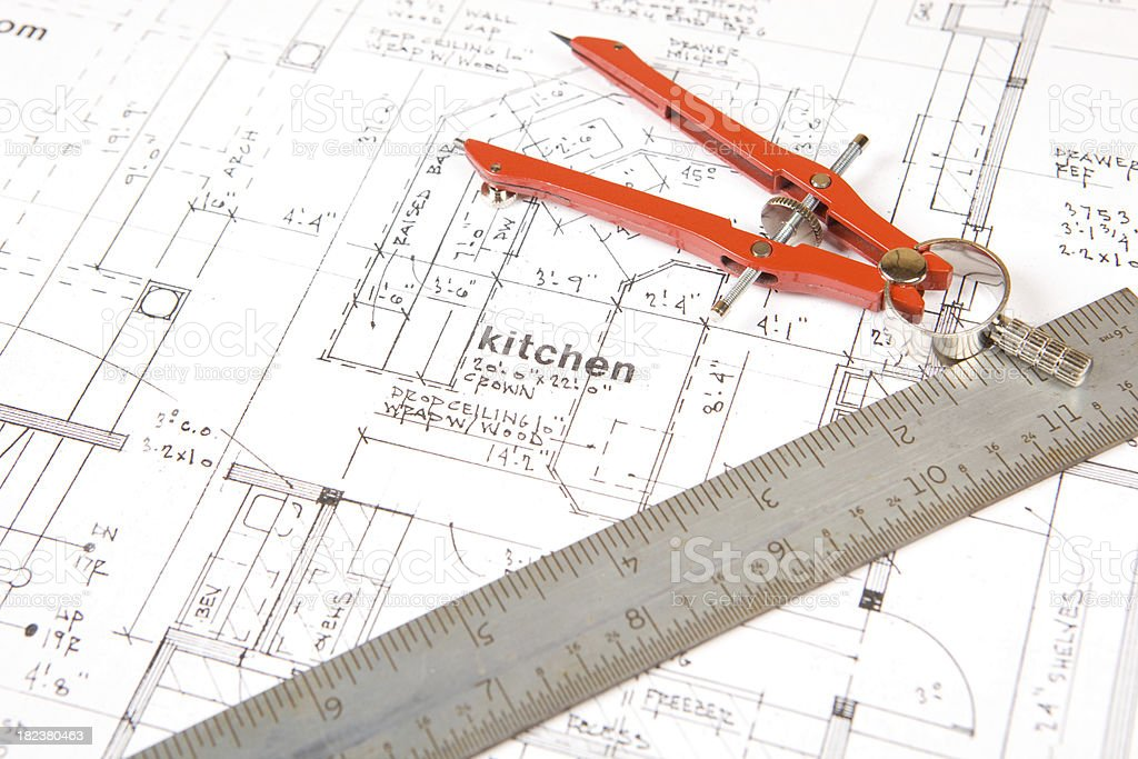 Compass and Steel Ruler on Home Plans (Kitchen) royalty-free stock photo