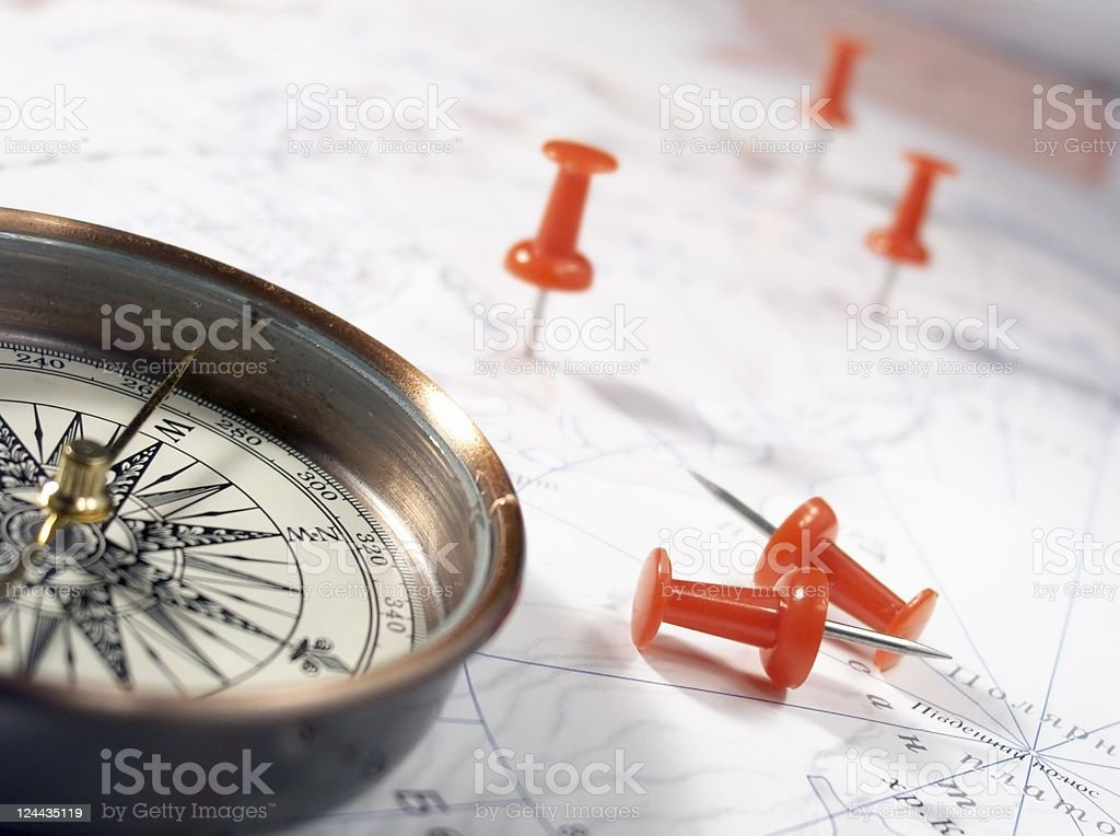 Compass and thumbtack on map royalty-free stock photo