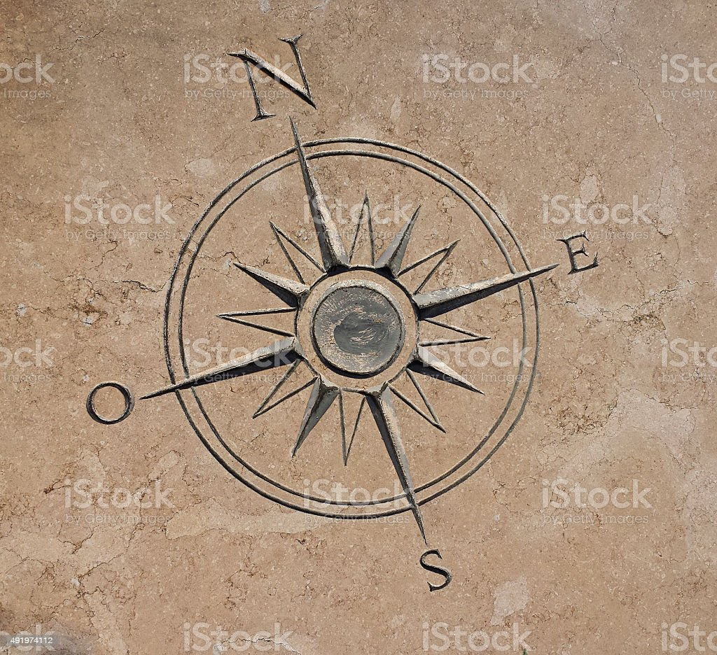 Compass carved in stone stock photo