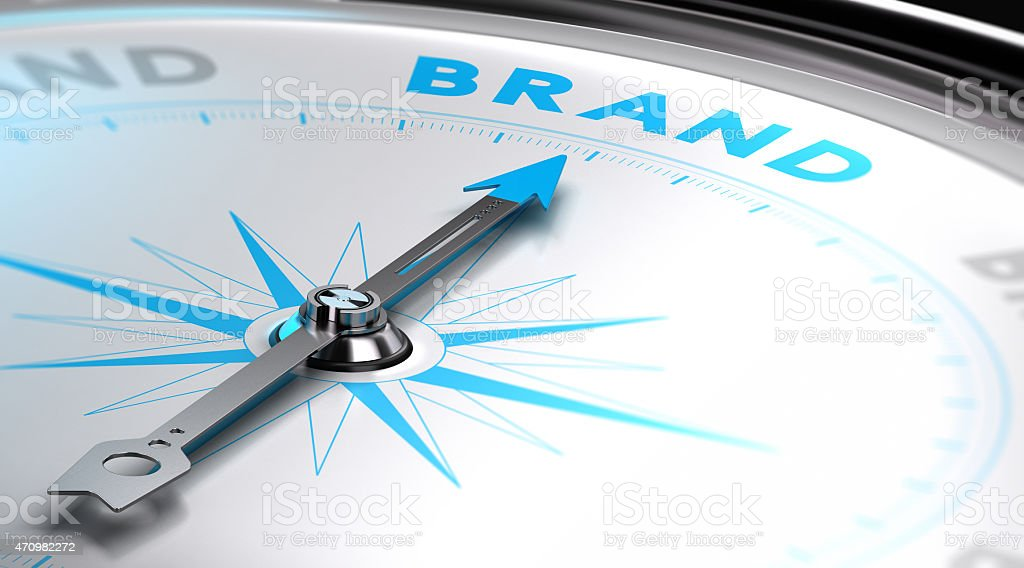 Compass dial pointing towards the word Brand stock photo