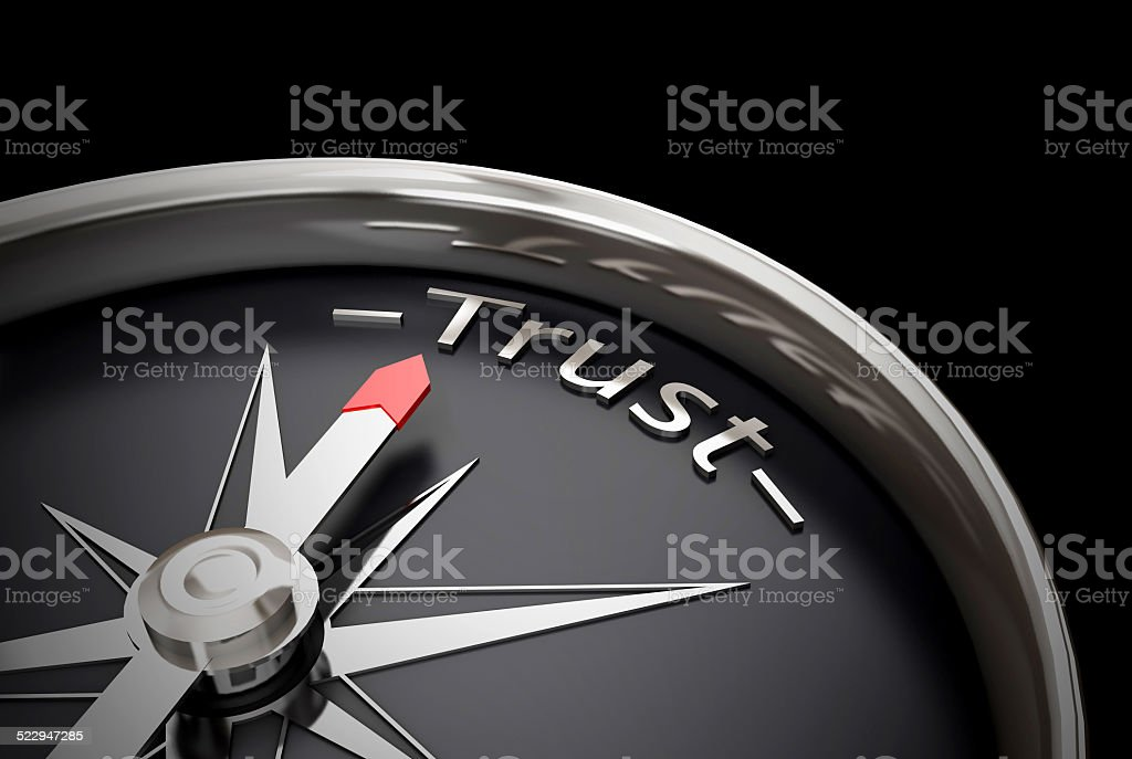 Compass direction pointing towards trust stock photo