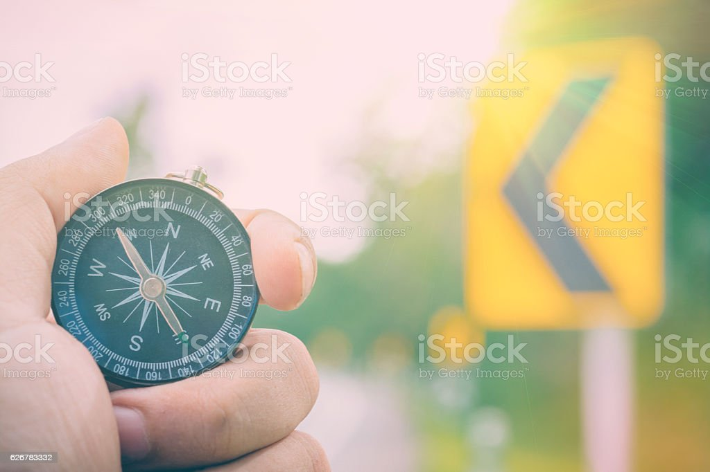 Compass in Hand Natural background .Vintage Tone. stock photo