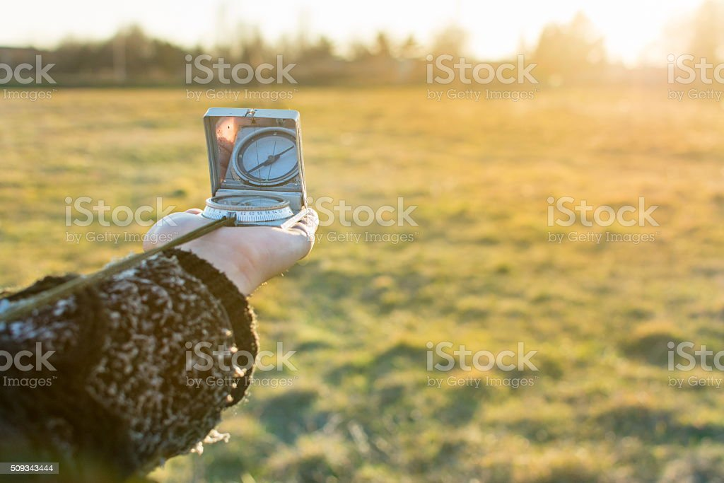 Compass in hand of a girl stock photo