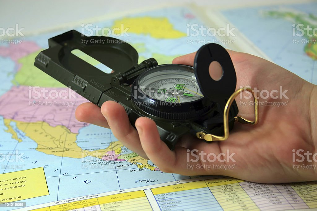 Compass in hand royalty-free stock photo