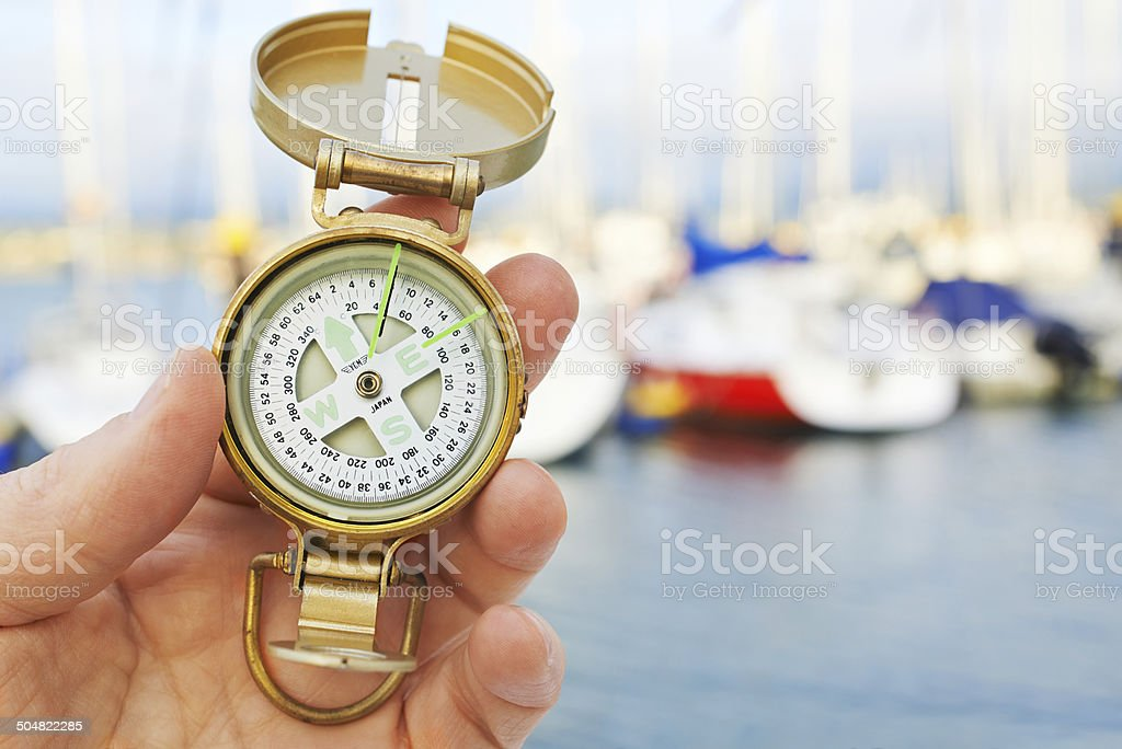 Compass in hand. royalty-free stock photo