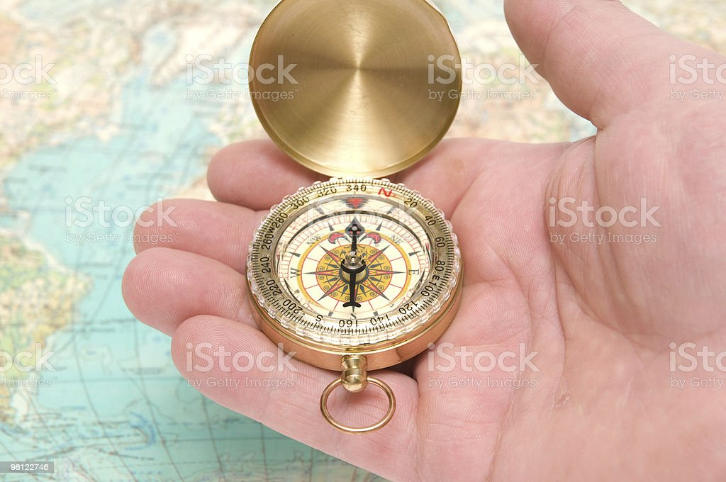Compass in hand stock photo
