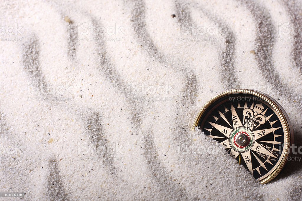 Compass in sand royalty-free stock photo