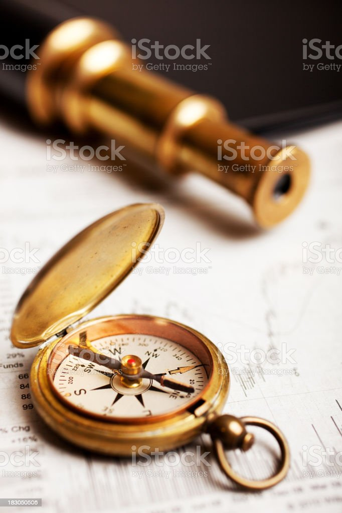Compass laying on a map royalty-free stock photo
