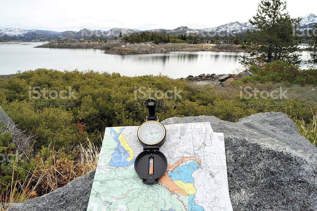 Compass, Map And Lake stock photo